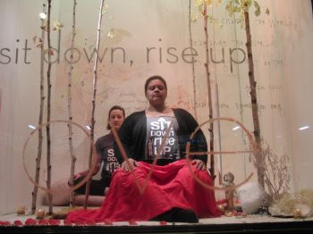 Members of the Interdependence Project are in the midst of a meditation marathon in the windows of ABC Home & Carpet (photo by twi-ny/mdr)