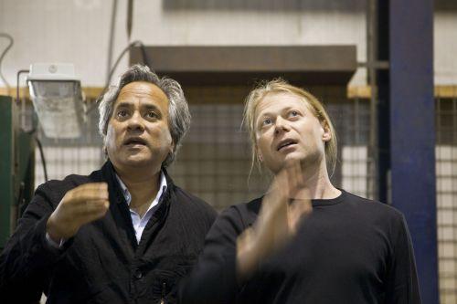"Anish Kapoor and Christopher Hornzee-Jones discuss construction of ""Memory"" (Photo: Mathias Schormann, © Anish Kapoor, Deutsche Guggenheim)"