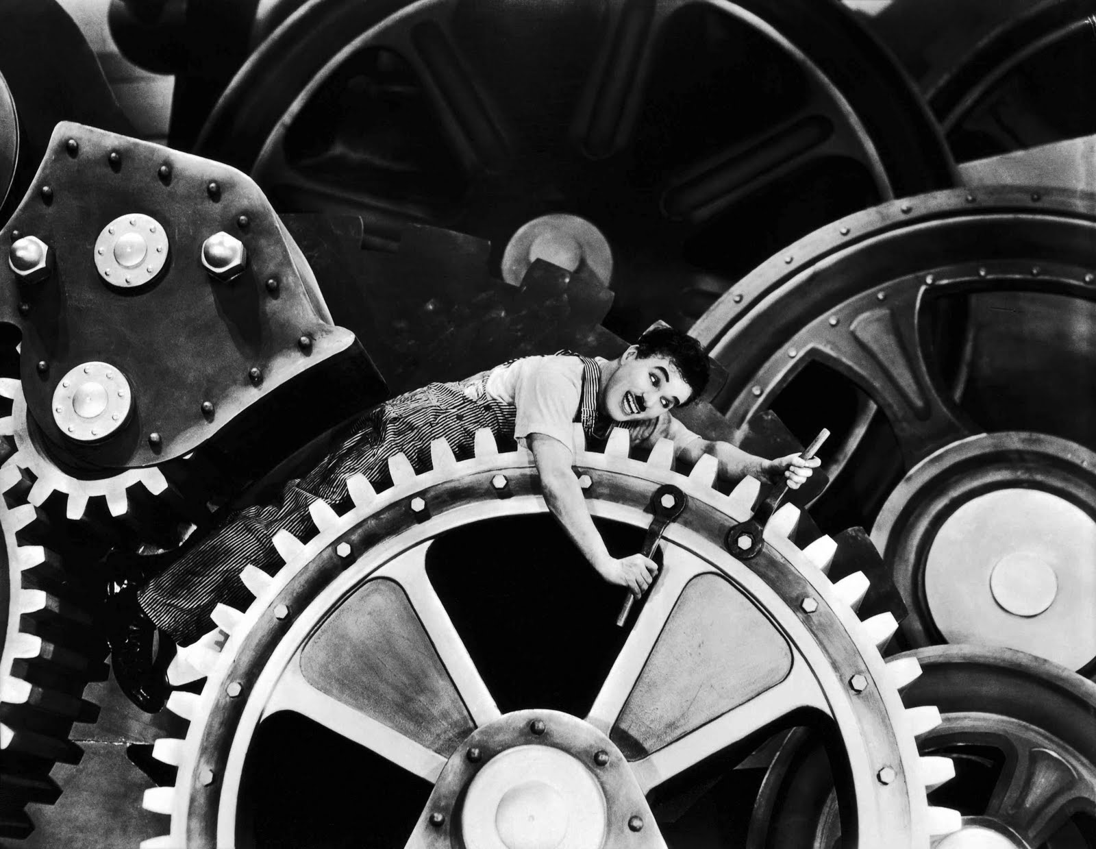 Charlie Chaplin gets caught up in the cogs of machinery in MODERN