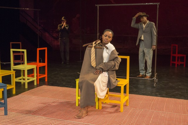 Matilda (Nonhlanhla Kheswa) clutches the object of her affection, and ultimate downfall, while Philomen (William Nadylam) sneaks up on her in THE SUIT (photo by Richard Termine)