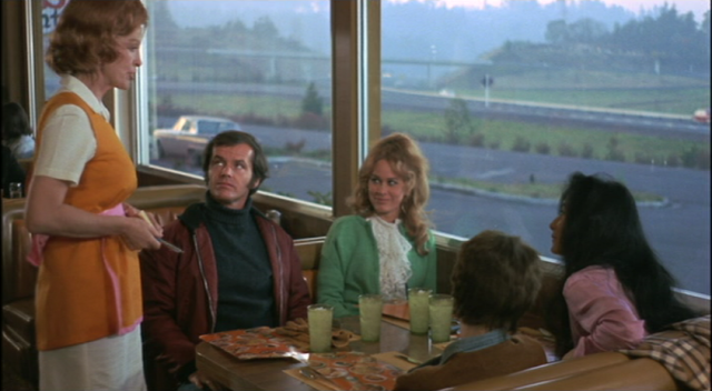Jack Nicholson, sitting next to Karen Black, is about to place the most famous sandwich order in film history