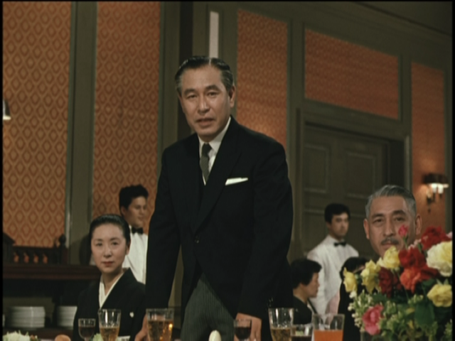 Wataru Hirayama (Shin Saburi) is a conflicted father-matchmaker in Yasujirō Ozu's first color film, EQUINOX FLOWER
