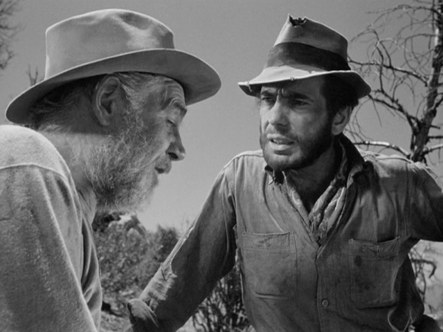 Howard (Walter Huston) and Dobbs (Humphrey Bogart) have differing views on gold in classic American Western