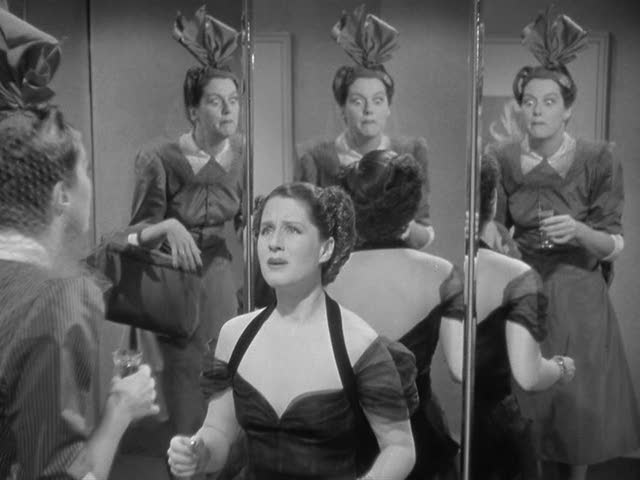 Mrs. Stephen Haines (Norma Shearer) learns the awful truth in George Cukor's THE WOMEN