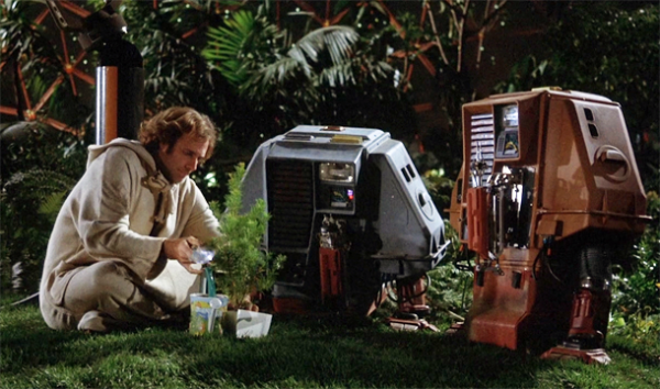 Freeman Lowell (Bruce Dern) and drones Dewey and Huey tend to a space garden in SILENT RUNNING