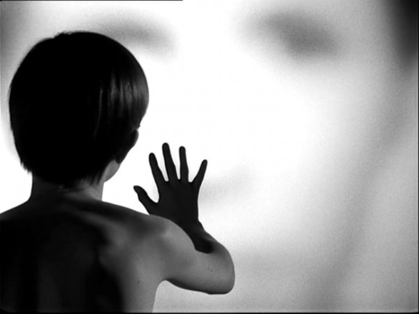 A young boy reaches out in avant-garde Bergman masterpiece
