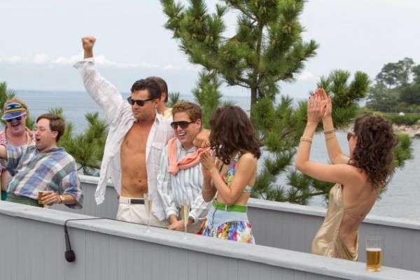 Stockbroker Jordan Belfort (Leonardo DiCaprio) and his team thinks they're invincible in THE WOLF OF WALL STREET