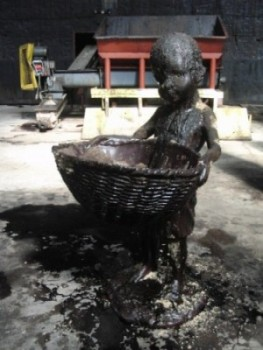 """Sugar Babies"" carry remnants of themselves in baskets at the Domino Sugar Factory (photo by twi-ny/mdr)"