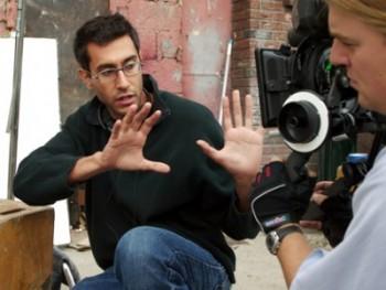 Director Ramin Bahrani frames a shot on the Willets Point set of CHOP SHOP