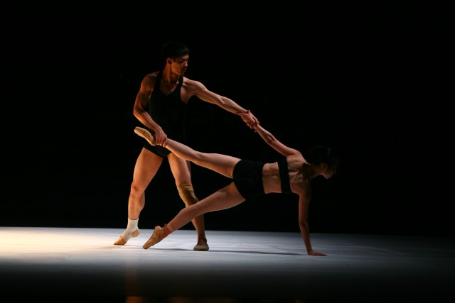 """Dancers glide across the stage in """"Farewell, Shadows,"""" second section of WILD GRASS (photo by Jan Jiang)"""