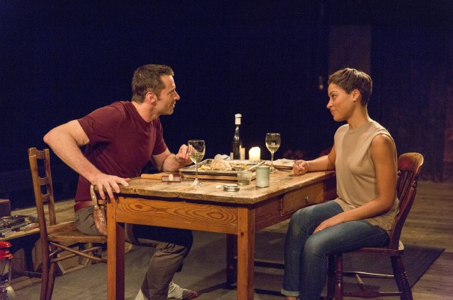 The Man (Hugh Jackman) and the Woman (Cush Jumbo) discuss life over dinner in THE RIVER (photo © 2014 Richard Termine)