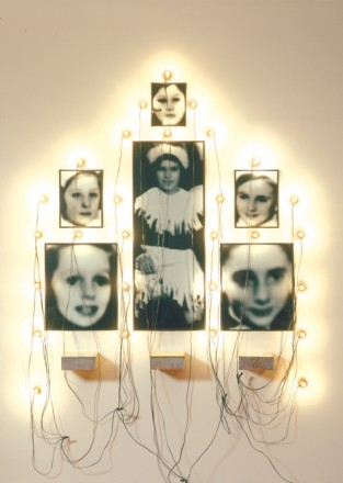 "Christian Boltanski,  ""Monument (Odessa),"" six gelatin silver prints, three tin biscuit boxes, lights, wire, dimensions variable, 1989–2003 (© Christian Boltanski / Courtesy of the Marian Goodman Gallery, New York)"