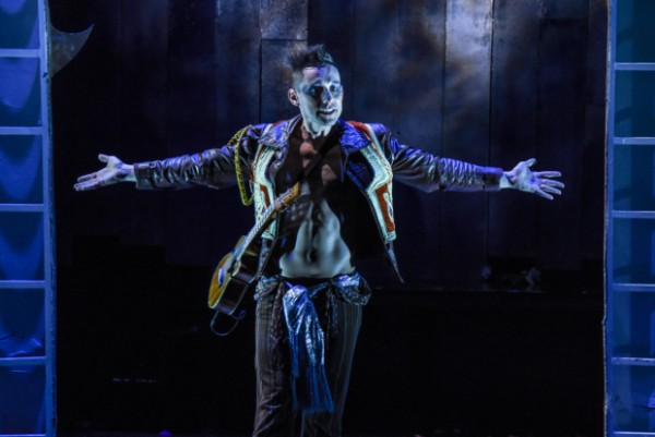 Nick Cearley stars as a musical Puck in Masterworks Theater (photo by Russ Rowland)