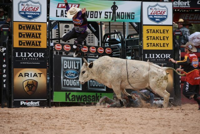 Tanner Byrne rides Mann Creek Buck N Bulls's Muddy Smile for 84.5 and Jesse Byrne is tossed during the second round of the Las Vegas Last Cowboy Standing Built Ford Tough series PBR. (Photo by Andy Watson / courtesy PBR/Bull Stock Media).