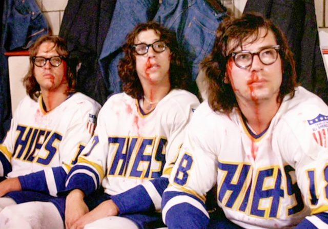 The Hanson Brothers revel in some old-time hockey in SLAP SHOT