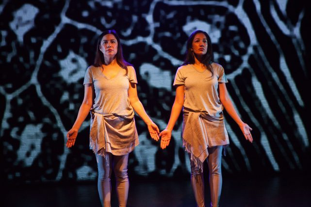 Purva Bedi and Mariana Newhard perform a duet in ASSEMBLED IDENTITY (photo by Benjamin Heller)