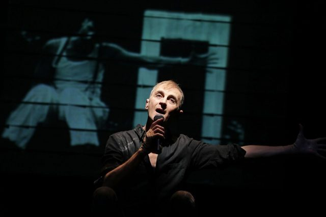 John Kelly looks back at his life and art in autobiographical one-man show (photo by Theo Cote)