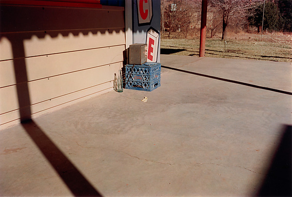 William Eggleston, Untitled (Bottle on Cement Porch), dye-transfer print, 1965-74, printed 2002 (© Eggleston Artistic Trust)