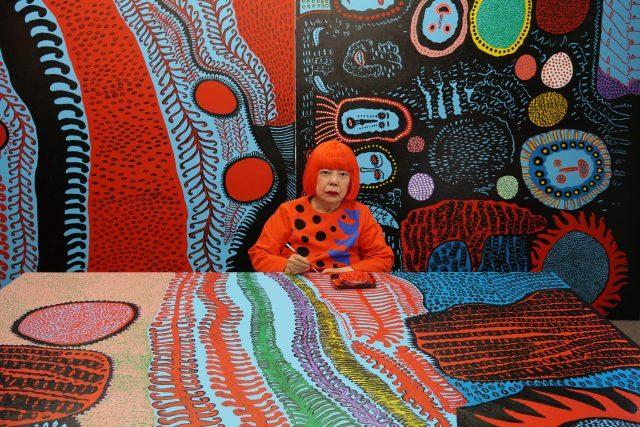 Portrait of Yayoi Kusama in her studio. Image © Yayoi Kusama. Courtesy of David Zwirner, New York; Ota Fine Arts, Tokyo/Singapore/Shanghai; Victoria Miro, London; YAYOI KUSAMA Inc.