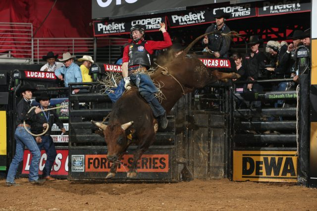Sean Willingham attempts to ride Torres Brothers Bucking Bulls LLC's Millennium's Buck during the second round of the Duluth PBR 25th Anniversary Unleash the Beast. Photo by Andy Watson