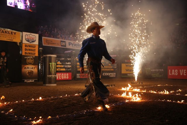 Sean Willingham, Fire, Pyro, in the opening during the third round of the Billings PBR 25th Anniversary Unleash the Beast. Photo by Andy Watson