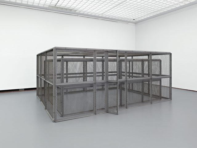 Bruce Nauman. Double Steel Cage Piece. 1974. Steel, 84 11⁄16 × 154 5⁄16 × 204 11⁄16″ (216 × 392 × 520 cm). Museum Boijmans van Beuningen, Rotterdam. © 2018 Bruce Nauman/Artists Rights Society (ARS), New York. Photo: Jannes Linders, Rotterdam